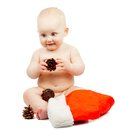 Positivity baby with cone and santa claus red hat isolated on white Stock Images