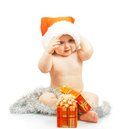 Positivity naked child in santa claus red hat with silver tinsel colorful christmas festive gift isolated on white Royalty Free Stock Photo