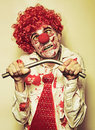 Possessed Horror Clown With Supernatural Strength Stock Images