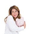Possessive about her savings closeup portrait happy beautiful business woman bank employee hugging holding piggy bank isolated Royalty Free Stock Images