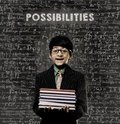 Possibilities genius little boy holding book wearing glasses cute intelligent and standing before a chalkboard chemical formulas Stock Photography