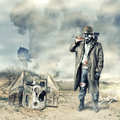Post apocalyptic survivor holding axe environmental disaster in gas mask Stock Photo