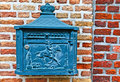 Post in netherlands blue boxe on the brick wall Stock Photos