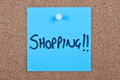 Post it note orange with shopping blue message on cork Royalty Free Stock Photo