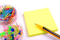 Post it note pad with pins pencil and paper clips Stock Photography