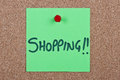 Post it note with shopping green message on cork Royalty Free Stock Image