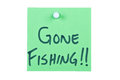 Post it note on wood in green with gone fishing Stock Images