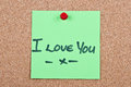 Post it note on wood in green with i love you Stock Photo
