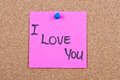 Post it note on wood in pink with i love you Royalty Free Stock Image