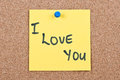 Post it note on wood in yellow with i love you Stock Image
