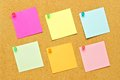 Post it notes on bulletin board Royalty Free Stock Photo