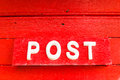 Post on the red background word Royalty Free Stock Photography
