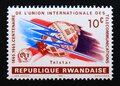 Post stamp Rwandan republic, 1965, space telecommunications Royalty Free Stock Photo