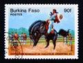 Postage stamp Burkina Faso 1985. Gauchos people, rodeo horseman Royalty Free Stock Photo