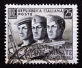Postage stamp Italy, 1952, Faces of sailor, airman and soldier Royalty Free Stock Photo