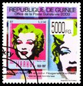 Postage stamp printed in Guinea shows Andy Warhol 1928-1987 «Marilyn» 1967, Marilyn Monroe and J.F. Kennedy on stamps, serie, Royalty Free Stock Photo
