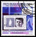 Postage stamp printed in Guinea shows Marilyn Monroe and J.F. Kennedy on stamps, USA 1964, serie, circa 2009 Royalty Free Stock Photo