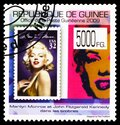 Postage stamp printed in Guinea shows Marilyn Monroe and J.F. Kennedy on stamps, USA 1995, serie, circa 2009 Royalty Free Stock Photo