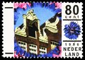 Postage stamp printed in Netherlands shows Detail of a house in Amsterdam, Holidays serie, circa 1996