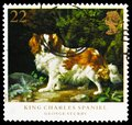 Postage stamp printed in United Kingdom shows Cavalier-King-Charles-Spaniel (Canis lupus familiaris), Dogs - Paintings by George