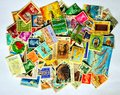 Postage stamps of different countries kept together Stock Images