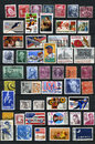 Postage stamps page of a stamp album with lots of old american on dark ground Royalty Free Stock Image