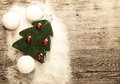 Postcard with a christmas tree christmas balls snowballs and snow on wooden background Stock Photography