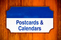 Postcards and calendars sign withd wood background Royalty Free Stock Images