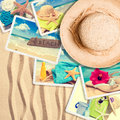 Postcards in the sand with summer straw hat Stock Photos