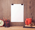 Poster mock up template hanging on wall with business objects Royalty Free Stock Photo