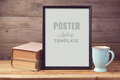 Poster mock up template with old books and coffee cup Royalty Free Stock Photo