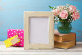 Poster mock up template with rose flower bouquet, gift box and books Royalty Free Stock Photo