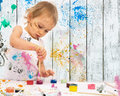 Poster paintings two year old girl paints with Stock Photos