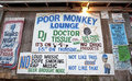 Posters outside the poor monkey lounge mississippi displayed Stock Photo