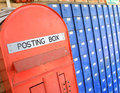 Posting box close crop image of brightly coloured blue and red post boxes Stock Images