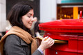 Posting mail a young woman letters Royalty Free Stock Photos