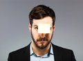 Postit on man face young with blank note the Stock Photos