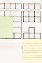 Postit notes on a keyboard attached to white Royalty Free Stock Photo