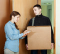 Postman brought package Royalty Free Stock Photo