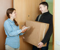 Postman brought package courier delivered a parcel to woman Stock Photography