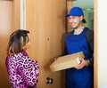 Postman delivered box to woman Royalty Free Stock Photo