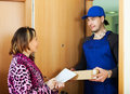 Postman delivered a package to woman Royalty Free Stock Photo