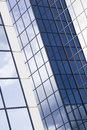 Postmodern glass office building abstract with reflected cloudy sky Royalty Free Stock Photos