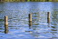 Posts in water three mooring wooden lake Stock Image