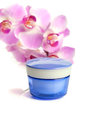 Pot of face/body cream and beautiful orchid flowers Stock Photo