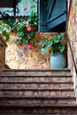 Pot with flowers summer study on the stone stairs a flower spain Royalty Free Stock Photos