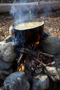 Pot with food on campfire Royalty Free Stock Photo