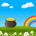 Pot of Gold and Rainbow in a Meadow Royalty Free Stock Photo