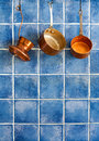 Pot, stewpot, coffee maker hanging on. Hanging retro design copper kitchenware set. Royalty Free Stock Photo