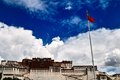 Potala Palace and Five-star Red Flag Stock Images